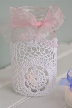 Baby Shower decor. Looks like a home crocheted doily simply put around a canning jar. What a neat idea.