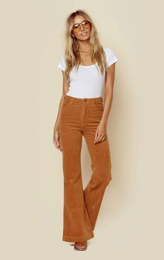 """Channel your 70's vibes in these super rad flares from Rolla's! Featuring a stretch corduroy fabrication, high waist styling with zip fly and button closure, and bell bottom shape. This style runs snug but will stretch after a few wears. Size up for a comfy fit! ImportedDry Clean OnlyCotton Poly BlendFit Guide:Model is 5ft 9 inches; Bust: 34"""", Waist: 25"""", Hips: 36""""Model is wearing a size 25Snug FitShoes Featured Not Available For Purchase"""