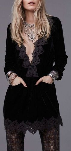 Sumptuous velvet lends touchable texture to a drop-waist tunic dress trimmed with beautiful scalloped lace at the plunging V-neckline and hem.