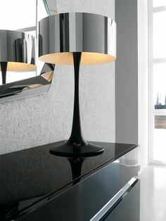 Table lamp with a White or Black Polyurethane base and a Shiny Stainless Steel lampshade