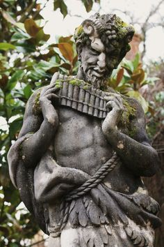 A statue of Pan, at Wisley Gardens, in the UK.