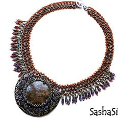 Bronzite beaded collar. This collar combines two beading techniques - bead embroidery and bead weaving. The backing of the embroidered part is genuine leather.