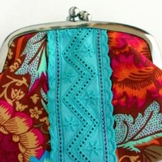 """An interview with the design-maker from """"iquantascores"""". ines designs beautiful bags and small purses."""