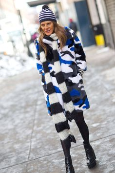 Anna Dello Russo in a camo print fur and netted beanie in NYC.