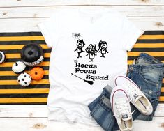 Hocus Pocus Shirt Women's Halloween T-shirt. Unique design will fun halloween elements added in as the witch broom and a spider looking on to the girls. Halloween Season, Halloween Fun, Hocus Pocus Shirt, Witch Broom, Cool T Shirts, Spider, T Shirts For Women, Group, Trending Outfits
