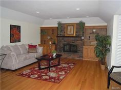 Family Room has cove ceiling, bay window, fireplace with flanking bookcases and wood floors