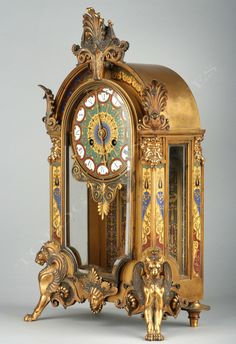 "This clock is an example of ""neo-byzantine design"". Although it seems to have characteristic of Baroque and victorian design, the piece is rooted in byzantine artwork with it's colorful and golden color scheme. Antique Desk, Antique Clocks, Antique Pendulum Wall Clock, Byzantine Architecture, Classic Clocks, Clock Shop, Retro Clock, Clocks For Sale, Wall Clock Online"
