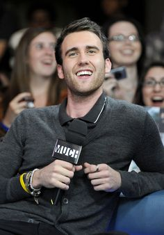 I guess they didn't let him fix his teeth until the movies were done. Neville is HOT.
