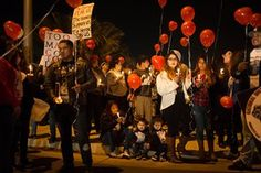 Family and friends gather at the location where James de La Rosa was killed in Bakersfield, California for the one year anniversary of his death.
