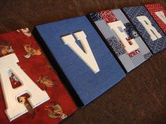 Cover a cheap picture frame with fabric, and put a wooden letter on top to spell baby's name!