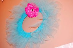 Turquoise tulle with bright pink flower