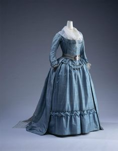 "Robe à l'anglaise, 1785, Pale blue striped silk; ""compères"" front; matching petticoat. Kyoto Costume Institute"