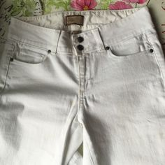 Paige Hidden Hills Boot White Denim SZ 27 Hey hi rise boot cut with a unique double button waistband. Front rise 9 inches inseam 34 1/2 inches leg opening 20 inches cotton polyester spandex blend. Very nice, will need cleaning at hem, see last pic... I wore them cuffed sometimes : ) Paige Jeans Jeans Boot Cut