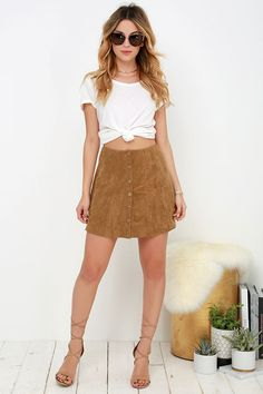 Your day just got ten times better now that you've stumbled upon the Suede My Day Tan Suede Skirt! A high, fitted waist tops this '70s inspired A-line skirt composed of soft microfiber suede. Brass snap-button placket, and vertical seaming completes the throwback look.