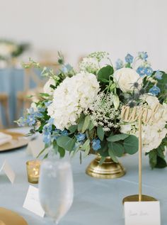 Farm tables, white wood cross back chairs and dusty blue linens with simple flor. Farm tables, white wood cross back chairs and dusty blue linens with simple floral and candle centerpieces created a sof. Blue Flower Centerpieces, White Centerpiece, Candle Centerpieces, Wedding Flower Arrangements, Centerpiece Ideas, Floral Arrangements, Blue White Weddings, White Wedding Flowers, Floral Wedding