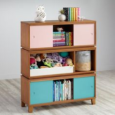 When we designed our District Furniture Collection, we thought back to the classic storage furniture we had in elementary school. Then we put a modern twist on the design, giving it a cleaner, more contemporary look. The 2 cube storage frame is compatible with the bin fronts, and provides plenty of room for your little one's library. The 3 cube storage frame works with two doors that slide across three spacious storage areas.