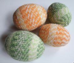 Easter eggs, self-made ; )   Yarn: Novita 7 Veljestä Aurora. Knitted on the styrofoam / polystyrene molds. Pääsiäinen, neuloen koristellut pääsiäismunat.