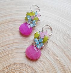 Like a beautiful spring flower bouquet, Primavera gemstone cluster earrings are bursting with color! I wire wrapped with sterling silver wire saturated fuchsia rock crystal pear briolette and adorned it with a rich cluster of spring green jade faceted rondelles, light blue jade