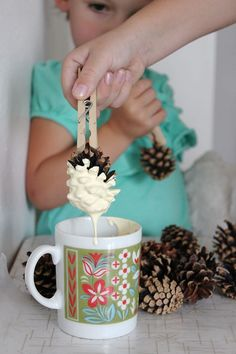 paint dipped pinecone garland - dip tops instead to look like snow covered pinecones