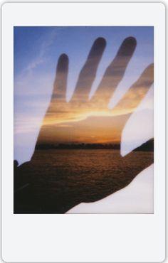 Hand over sunset. | Instax Mini 90 handles double exposure like a pro! | photo cred Fumihiko Suzuki
