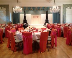 Twin Eiffel towers set the stage at NCL Springtime in Paris fashion show featuring Tootsie's fashions. By Fleur de VIe.