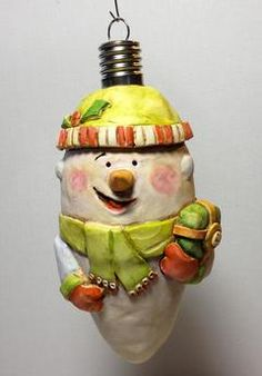Polymer clay ornament.  Snowman made of clay over glass by Mercedese Bantz