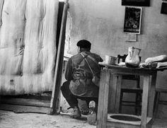 Robert Capa — SPAIN, Madrid. Members of the International Brigades, engaged in a house to house fight around the slaughterhouse, near the university campus, in the western outskirts of the capital. The Fascist rebels were mounting a major offense in order to capture Madrid (November-December 1936)