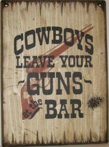 Western Wall Sign Saloon: Leave Your Guns At The Bar! Hang this up and you won't have any trouble with outlaws! Handmade of pine made in the USA.