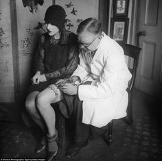 Tattooing a butterfly garter belt, 1930s