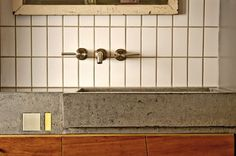 Kitchen Counter or bathroom. I like the cement with a thin layer of finished top.