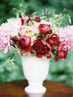 Pink and red wedding flowers by JMFlora Design, image by Laura Gordon.
