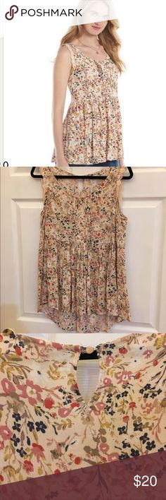 Lauren Conrad Sleeveless Blouse This Lauren Conrad sleeveless blouse has a babydoll flowy like fit. It has a gorgeous floral pattern in pinks, blues, greens, and yellows. Romantic details like lace at the end of each arm, pleating in the front, and decorative shell buttons adorn this beautiful shirt! Has a slight high/low hem to it. Only worn and washed once per instructions, this shirt is practically new and is looking for a trendy new home 💗 LC Lauren Conrad Tops Blouses