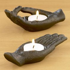 One of my favorite discoveries at WorldMarket.com: Aluminum Hand Tealight Holders, Set of 2