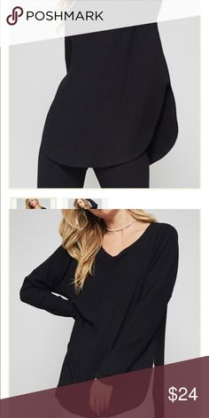 Robbed Long Sleeve Loose fit, long sleeves, round neck, ribbed top. Featuring side slits. This top is made with medium weight ribbed fabric. Super soft!  Material: 96% Rayon/ 4% Spand Tops