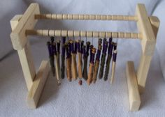 Table Top Stand for Holding Wound Bobbin Pairs. Will hold 32 pairs of bobbins for making bobbin lace, honiton lace or pillow lace