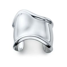 A work of art for your wrist, this sculpted silver cuff will punctuate every outfit. Tiffany & Co. Elsa Peretti® Bone Cuff, $1,150; tiffany.com.    - MarieClaire.com