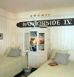antique hutch keeps books handy between Nantucket-style twin beds - just beachy!