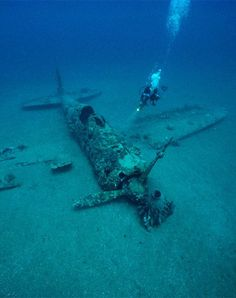 A diver explores the wreckage of a Japanese World War II fighter plane near the town of Rabaul in Papua New Guinea. Description from facsimilemagazine.com. I searched for this on bing.com/images