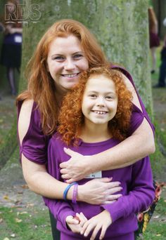 Mom and redhead daughter hugging