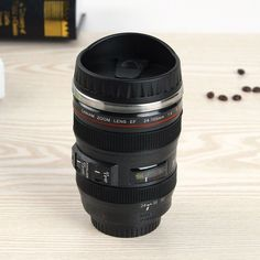 Impress your friends with this coffee cup that looks like a camera lens.Leak proof seal proof coffee cup camera lens. Use it as a travel mug or thermos. Mocha Supply