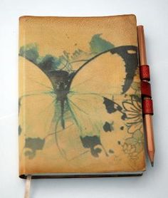 I love writing in pretty journals.     Free Initials Butterfly leather journal by revitalbookarts on Etsy