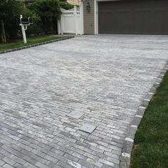 Wow your neighbors with a beautiful Cambridge driveway. These homeowners used Cambridge's Brick Alley pavers.