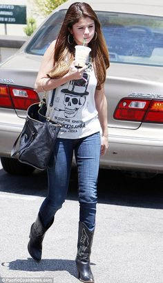 Sweet Selena Gomez rocks a smoking skull T-shirt and black leather cowboy boots