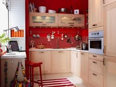 See more here (http://www.shelterness.com/31-practical-kitchen-rail-storage-ideas/) I ♥ these ideas!