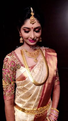 Our gorgeous bride Aishwarya looks ravishing for her muhurtam. Makeup and hairstyle by Vejetha for Swank Studio. Pink lips. Bridal jewelry. Jhumkis. Nose ring. Bridal hair. Silk sari. Bridal Saree Blouse Design. Indian Bridal Makeup. Indian Bride. Gold Jewellery. Statement Blouse. Tamil bride. Telugu bride. Kannada bride. Hindu bride. Malayalee bride. Find us at https://www.facebook.com/SwankStudioBangalore