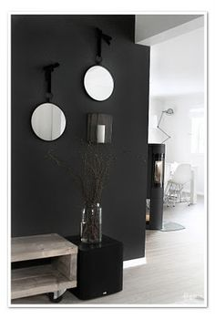 Black walls done right, very cool. I hope my future home has a good place for this :)