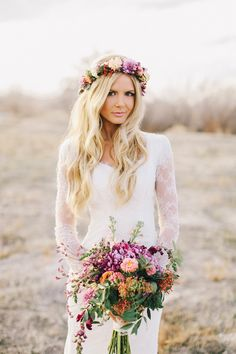 bohemian bride in a lace sleeve wedding dress