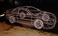 JAPANESE CLASSIC - BENEDICT RADCLIFFE  BENEDICT'S SIGNATURE WIRE FRAME TECHNIQUE WAS USED TO DRAW THE SUBARU IMPREZA P1, LIFE SIZE IN SCALE, IN THREE DIMENSIONS AND SPRAYED ARTIC WHITE.   MADE FROM 10MM STEEL ROUND BAR, ALL WELDS WERE FILED AWAY GIVING AN IMPRESSION OF FLUIDITY AND CONTINUOUSNESS.  @BENEDICTRADCLIFFE