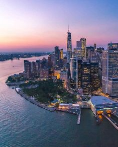 Lower Manhattan at dusk by Central Park, Empire State Building, Best Places To Travel, Places To Visit, Little Italy New York, A New York Minute, Destinations, City Aesthetic, Lower Manhattan