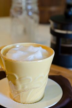 Quick and easy milk froth for your latte.  Pour a mason jar hall full with the milk of your choice, put the lid tightly on and shake for 30 seconds.  Then remove the lid and microwave for 30 seconds using a spoon to hold the froth down. Then enjoy